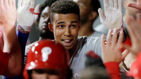 Philadelphia Phillies' Aaron Altherr is greeted in the dugout after he hit a two-run home run during the ninth inning of the team's baseball game against the Seattle Mariners, Tuesday, June 27, 2017, in Seattle. (AP Photo/Ted S. Warren)