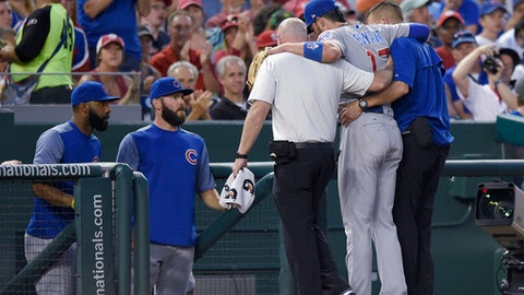 Chicago Cubs third baseman Kris Bryant (17) is helped off the field by trainers after he was injured during the fifth inning of the team's baseball game against the Washington Nationals, Wednesday, June 28, 2017, in Washington. (AP Photo/Nick Wass)