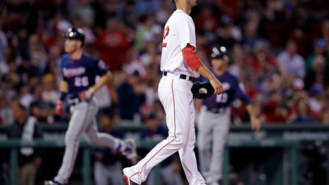 Boston Red Sox starting pitcher Rick Porcello walks back to the mound as Minnesota Twins' Max Kepler rounds the bases on his two-run home run during the sixth inning of a baseball game at Fenway Park in Boston, Wednesday, June 28, 2017. (AP Photo/Charles Krupa)