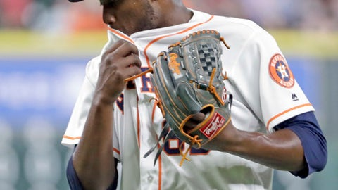 Houston Astros starting pitcher David Paulino wipes his face after giving up a three-run home run to Oakland Athletics' Khris Davis during the third inning of a baseball game, Wednesday, June 28, 2017, in Houston. (AP Photo/David J. Phillip)