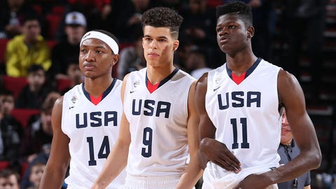 PORTLAND, OR - APRIL 7: Wendell Carter Jr. #14, Michael Porter Jr. #9 and Mohammed Bamba #11 of the USA Junior Select Team looks on against the World Select Team during the game on April 7, 2017 at the MODA Center Arena in Portland, Oregon. NOTE TO USER: User expressly acknowledges and agrees that, by downloading and or using this photograph, User is consenting to the terms and conditions of License Agreement. Mandatory Copyright Notice: Copyright 2017 NBAE (Photo by Sam Forencich)