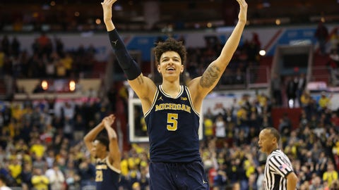 Mar 12, 2017; Washington, DC, USA; Michigan Wolverines forward D.J. Wilson (5) celebrates in the closing seconds of the second half against the Wisconsin Badgers during the Big Ten Conference Tournament championship game at Verizon Center. The Wolverines won 71-56. Mandatory Credit: Geoff Burke-USA TODAY Sports