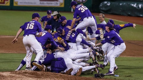 BATON ROUGE, LA - JUNE 11: LSU pitcher Jared Poche' (16) looks to get into the dog pile after the Baton Rouge Division I Super Regional game between Mississippi St. and LSU on June 11, 2017, at Alex Box Stadium in Baton Rouge, LA. (Photo by Stephen Lew/Icon Sportswire) (Icon Sportswire via AP Images)