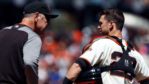 SAN FRANCISCO, CA - JUNE 25: Bruce Bochy #15 of the San Francisco Giants talks to Buster Posey #28 while making a pitching change during the fifth inning against the New York Mets at AT&T Park on June 25, 2017 in San Francisco, California. The New York Mets defeated the San Francisco Giants 8-2.  (Photo by Jason O. Watson/Getty Images)