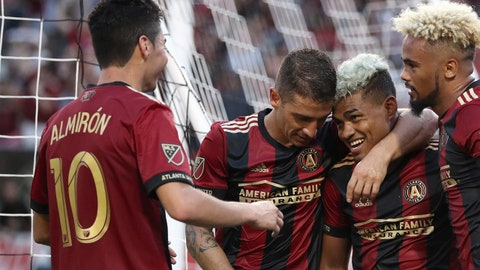 Jun 24, 2017; Atlanta, GA, USA; Atlanta United forward Josef Martinez (second from right) celebrates his goal with midfielder Miguel Almiron (10) and midfielder Carlos Carmona (second from left) and midfielder Anton Walkes (26) in the second half against the Colorado Rapids at Bobby Dodd Stadium at Historic Grant Field. Mandatory Credit: Jason Getz-USA TODAY Sports