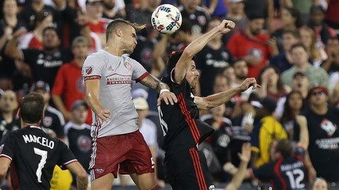 Jun 21, 2017; Washington, DC, USA; Atlanta United FC defender Leandro Gonzalez (5) and D.C. United defender Steve Birnbaum (15) leap to head the ball in the second half at Robert F. Kennedy Memorial Stadium. D.C. United won 2-1. Mandatory Credit: Geoff Burke-USA TODAY Sports