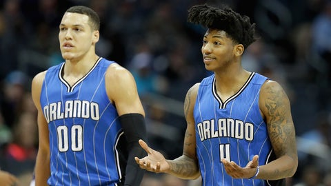 CHARLOTTE, NC - MARCH 10:  Teammates Aaron Gordon #00 and Elfrid Payton #4 of the Orlando Magic react after a call during their game against the Charlotte Hornets at Spectrum Center on March 10, 2017 in Charlotte, North Carolina. NOTE TO USER: User expressly acknowledges and agrees that, by downloading and or using this photograph, User is consenting to the terms and conditions of the Getty Images License Agreement.  (Photo by Streeter Lecka/Getty Images)