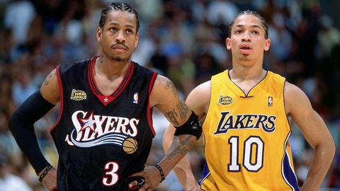 LOS ANGELES - JUNE 6:  Allen Iverson #3 of the Philadelphia 76ers stands with Tyronn Lue #10 of the Los Angeles Lakers during game one of the 2001 NBA Finals played June 6, 2001 at the Staples Center in Los Angeles, California.  NOTE TO USER: User expressly acknowledges that, by downloading and or using this photograph, User is consenting to the terms and conditions of the Getty Images License agreement. Mandatory Copyright Notice: Copyright 2001 NBAE (Photo by Nathaniel S. Butler/NBAE via Getty Images)