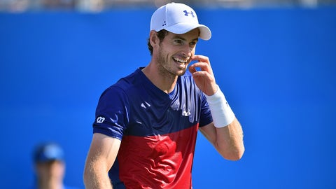 Britain's Andy Murray reacts while playing Australia's Jordan Thompson during their men's singles first round tennis match at the ATP Aegon Championships tennis tournament at Queen's Club in west London on June 20, 2017. / AFP PHOTO / GLYN KIRK        (Photo credit should read GLYN KIRK/AFP/Getty Images)