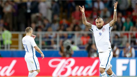 Chile's Arturo Vidal celebrates after scoring during the Confederations Cup, Group B soccer match between Cameroon and Chile, at the Spartak Stadium in Moscow, Sunday, June 18, 2017. (AP Photo/Pavel Golovkin)