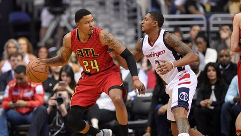 Atlanta Hawks forward Kent Bazemore (24) dribbles against Washington Wizards guard Bradley Beal (3) during the first half in Game 5 of a first-round NBA basketball playoff series, Wednesday, April 26, 2017, in Washington. (AP Photo/Nick Wass)