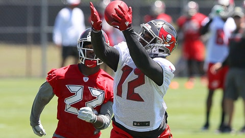 TAMPA, FL - MAY 06: Chris Godwin (12) extends his arms to bring in the pass as Tyquwan Glass (22) looks on during the Buccaneers Rookie Camp on May 06, 2017 at One Buccaneer Place in Tampa, Florida. (Photo by Cliff Welch/Icon Sportswire via Getty Images)