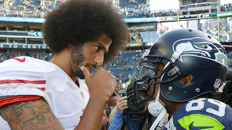San Francisco 49ers quarterback Colin Kaepernick, left, talks with Seattle Seahawks wide receiver Doug Baldwin, right, following an NFL football game, Sunday, Sept. 25, 2016, in Seattle. The Seahawks defeated the 49ers 37-18. (AP Photo/Ted S. Warren)