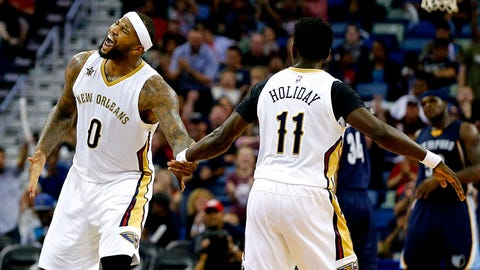 NEW ORLEANS, LA - MARCH 21:  DeMarcus Cousins #0 of the New Orleans Pelicans reacts with Jrue Holiday #11 of the New Orleans Pelicans after an assist against the Memphis Grizzlies during the second half at the Smoothie King Center on March 21, 2017 in New Orleans, Louisiana. The Pelicans won the game 95 - 82. NOTE TO USER: User expressly acknowledges and agrees that, by downloading and or using this photograph, User is consenting to the terms and conditions of the Getty Images License Agreement.  (Photo by Sean Gardner/Getty Images)