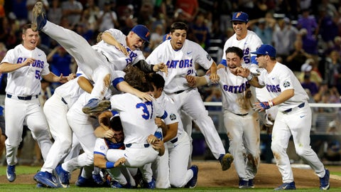 Florida players celebrate after defeating LSU in Game 2 to win the NCAA College World Series baseball finals in Omaha, Neb., Tuesday, June 27, 2017. (AP Photo/Nati Harnik)