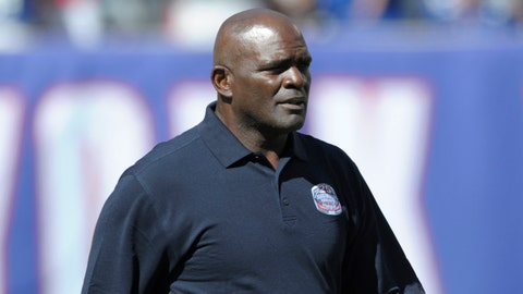 Former New York Giants' Lawrence Taylor walks onto the field during a 25 year anniversary celebration at halftime of an NFL football game against the Atlanta Falcons, Sunday, Sept. 20, 2015, in East Rutherford, N.J. (AP Photo/Bill Kostroun)