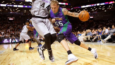 3 Headed Monsters Jason Williams (55) drives up against Ghost Ballers Ivan Johnson (44) during the first half of Game 1 in the BIG3 Basketball League debut, Sunday, June 25, 2017, at the Barclays Center in New York. (AP Photo/Kathy Willens)
