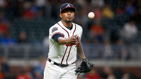 Jun 20, 2017; Atlanta, GA, USA; Atlanta Braves starting pitcher Julio Teheran (49) tosses to first for an out against the San Francisco Giants in the seventh inning at SunTrust Park. Mandatory Credit: Brett Davis-USA TODAY Sports