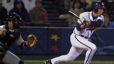 Atlanta Braves Keith Lockhart drives in the winning run with a base hit off New York Mets pitcher Turk Wendell as catcher Mike Piazza looks on in the 9th inning against the New York Mets Wednesday, April 4, 2001 in Atlanta.  The Braves beat the Mets 3-2.  (AP Photo/John Bazemore)