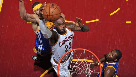 CLEVELAND, OH - JUNE 7:  LeBron James #23 of the Cleveland Cavaliers drives to the basket against the Golden State Warriors in Game Three of the 2017 NBA Finals on June 7, 2017 at Quicken Loans Arena in Cleveland, Ohio. NOTE TO USER: User expressly acknowledges and agrees that, by downloading and or using this photograph, user is consenting to the terms and conditions of Getty Images License Agreement. Mandatory Copyright Notice: Copyright 2017 NBAE (Photo by Garrett Ellwood/NBAE via Getty Images)