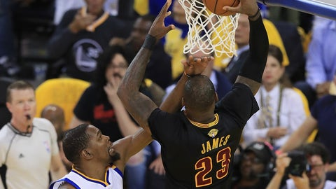 OAKLAND, CA - JUNE 12:  LeBron James #23 of the Cleveland Cavaliers dunks the ball against Kevin Durant #35 of the Golden State Warriors in Game 5 of the 2017 NBA Finals at ORACLE Arena on June 12, 2017 in Oakland, California. NOTE TO USER: User expressly acknowledges and agrees that, by downloading and or using this photograph, User is consenting to the terms and conditions of the Getty Images License Agreement.  (Photo by Ronald Martinez/Getty Images)