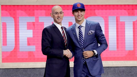 Duke's Luke Kennard poses for photos with NBA Commissioner Adam Silver after being selected by the Detroit Pistons as the 12th pick overall during the NBA basketball draft, Thursday, June 22, 2017, in New York. (AP Photo/Frank Franklin II)