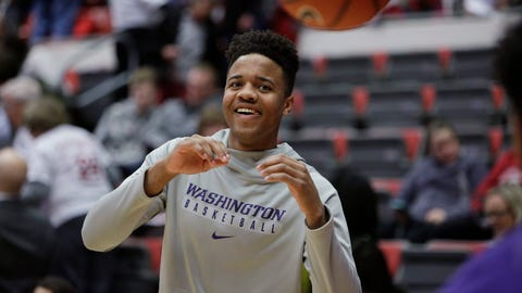 This Feb. 26, 2017 photo shows Washington guard Markelle Fultz, who is out with a sore knee, having a ball passed to him before an NCAA college basketball game against Washington State in Pullman, Wash. His final moments of college were spent as a cheerleader. Reduced to sitting on the bench of a glitzy Las Vegas arena, hoping the teammates he bonded with for his one season could extend their run for another day just so he could cheer again. (AP Photo/Young Kwak)