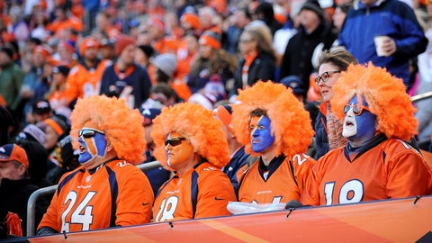 DENVER, CO - JANUARY 17: Denver Broncos fans with face paint and orange wigs watch  during the AFC Divisional Playoff Game between the Denver Broncos and the Pittsburgh Steelers at Sports Authority Field at Mile High on January 17, 2016 in Denver, Colorado.  (Photo by Dustin Bradford/Getty Images)