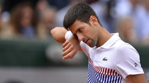 PARIS, FRANCE - JUNE 07:  Novak Djokovic of Serbia reacts during the men's singles quarterfinal match against Dominic Thiem of Austria  on day eleven of the 2017 French Open at Roland Garros on June 7, 2017 in Paris, France.  (Photo by Aurelien Meunier/Getty Images)