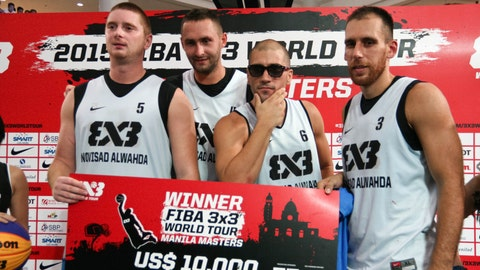 MANILA, PHILIPPINES - 2015/08/02: Team NoviSad AlWahda from the UAE pose as they receive their cheque for US$10,000 at the Robinsons Mall in Manila. NoviSad AlWahda won the Manila leg of the FIBA 3X3 competition against Team Manila North with a score of 21-14. (Photo by J Gerard Seguia/Pacific Press/LightRocket via Getty Images)