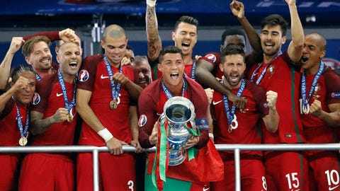 Portugal's Cristiano Ronaldo , center, after the Euro 2016 final soccer match between Portugal and France at the Stade de France in Saint-Denis, north of Paris, Sunday, July 10, 2016. (AP Photo/Frank Augstein)