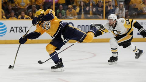 Nashville Predators right wing Craig Smith , left, shoots the puck as Pittsburgh Penguins defenseman Ron Hainsey, right, defends during the third period in Game 3 of the NHL hockey Stanley Cup Finals Saturday, June 3, 2017, in Nashville, Tenn. (AP Photo/Mark Humphrey)