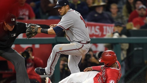 May 31, 2017; Anaheim, CA, USA; Los Angeles Angels catcher Martin Maldonado (12) is forced out at third by Atlanta Braves third baseman Rio Ruiz (14) during the seventh inning at Angel Stadium of Anaheim. Mandatory Credit: Kelvin Kuo-USA TODAY Sports
