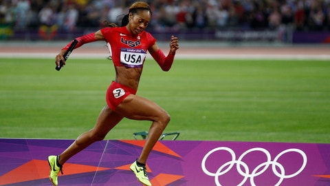 United States' Sanya Richards-Ross leads to win in the women's 4 x 400-meter relay during the athletics in the Olympic Park during the 2012 Summer Olympics, Saturday, Aug. 11, 2012, in London. (AP Photo/Jon Super)
