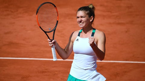 Romania's Simona Halep celebrates after winning her tennis match against Ukraine's Elina Svitolina at the Roland Garros 2017 French Open on June 7, 2017 in Paris.  / AFP PHOTO / Eric FEFERBERG        (Photo credit should read ERIC FEFERBERG/AFP/Getty Images)