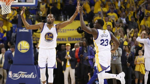 OAKLAND, CA - JUNE 12:  Kevin Durant #35 and Draymond Green #23 of the Golden State Warriors celebrate after a play in Game 5 of the 2017 NBA Finals against the Cleveland Cavaliers at ORACLE Arena on June 12, 2017 in Oakland, California. NOTE TO USER: User expressly acknowledges and agrees that, by downloading and or using this photograph, User is consenting to the terms and conditions of the Getty Images License Agreement.  (Photo by Ezra Shaw/Getty Images)