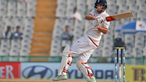 Root playing a shot on the fourth day of their third cricket test match against India in Mohali India. The prospect of both teams being under new captains adds extra intrigue _ and a sligh