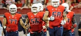 Arizona counts on veteran O-line to ease transition for rebuilt backfield