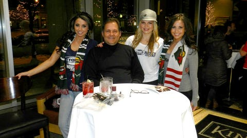 The FOX Sports North Girls watched the 1st period of the Wild & Oilers game at Kincaid's with fans.