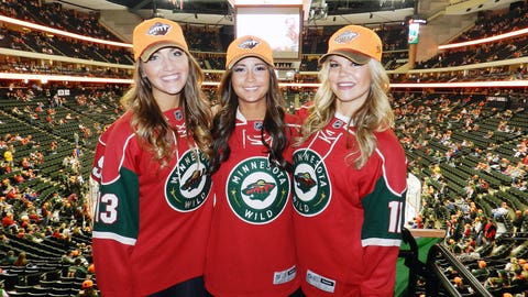 """The FOX Sports North Girls get ready to kick off the Wild game with the """"Let's Play Hockey"""" announcement."""