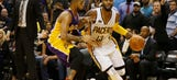 George leads Pacers past Lakers 115-108