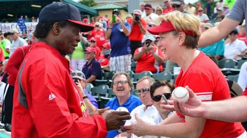 Lou Brock signs autograph for St. Louis Cardinals fan