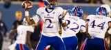 West Virginia hands Kansas 40th straight road loss