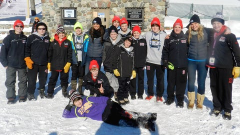 Kaylin and Kendall pose with a youth hockey team