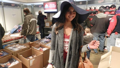 Angie checks out some of the items at the Twins Yard Sale