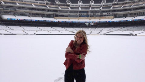 Kendall tries to stay warm while taking a few pictures in the outfield