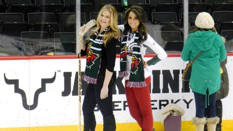 Kendall and Kaylin celebrate the Wild's 3-2 OT victory by taking a few slapshots on the ice