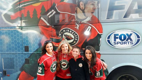 The FOX Sports North Girls welcomed Wild season ticket holders to the game as they arrived on the FOX Sports North Fan Express bus.