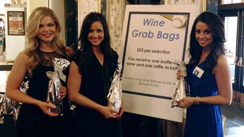 "The FOX Sports North Girls were stationed at the ""Wine Grab Bags"" table at the Capital Grille Celebrity Waiter event. Proceeds benefited the Boys & Girls Clubs of the Twin Cities."
