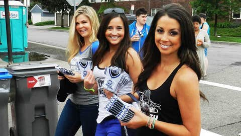 Distributing FOX Sports North Girls coozies to fans along historic Grand Avenue.